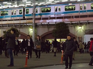 Workers returning to the home at Shinbashi station in Tokyo