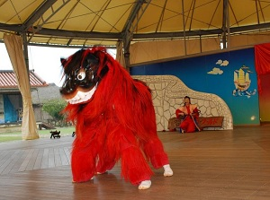 Performance of Lion dance in Okinawa World